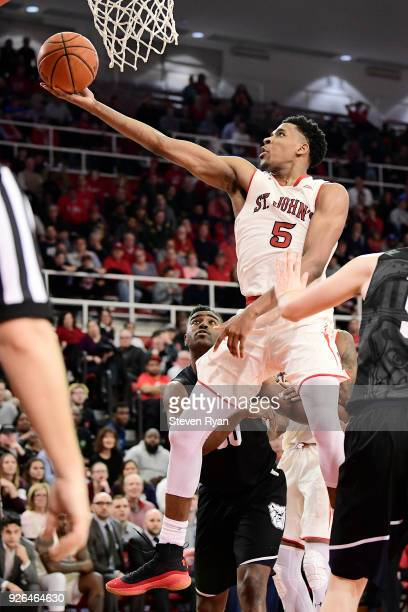 Justin Simon of the St John's Red Storm attempts a lay up against the Butler Bulldogs during an NCAA basketball game at Carnesecca Arena on February...