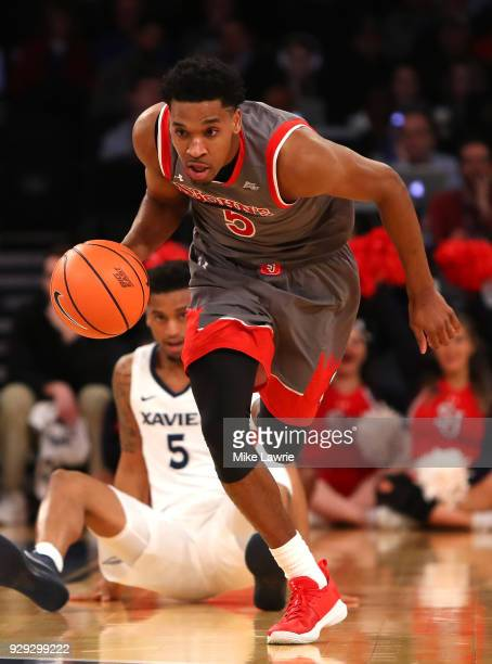 Justin Simon of the St John's Red Storm brings the ball up court after a steal against Trevon Bluiett of the Xavier Musketeers in the first half in...