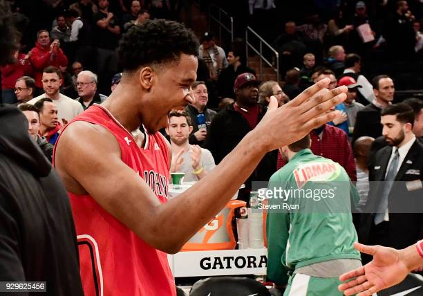Justin Simon of the St John's Red Storm celebrates a victory over the Georgetown Hoyas during the first round of the Big East tournament at Madison...