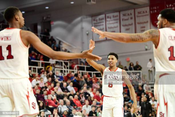 Justin Simon of the St John's Red Storm celebrates the play against the Butler Bulldogs during an NCAA basketball game at Carnesecca Arena on...