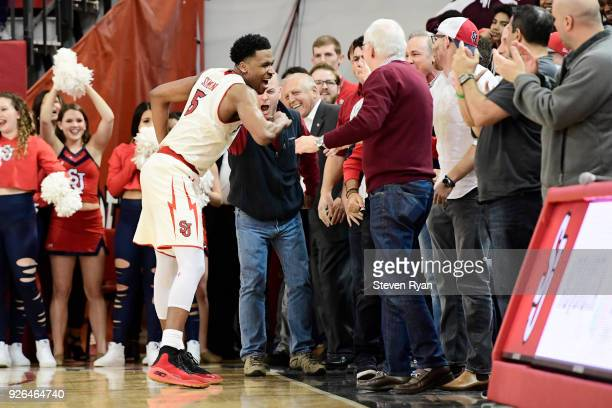 Justin Simon of the St John's Red Storm celebrates with the fans after his team secures the lead late in the overtime period against the Butler...