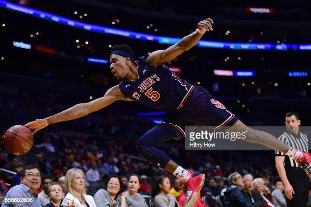 Justin Simon of the St John's Red Storm dives for a loose ball in the game against the Arizona State Sun Devils during the Basketball Hall of Fame...