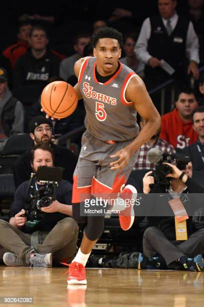 Justin Simon of the St John's Red Storm dribbles up court during the quarterfinal round of the Big East Basketball Tournament against the Xavier...
