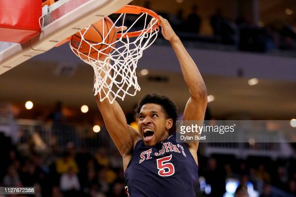 Justin Simon of the St. John's Red Storm dunks the ball in the second half against the Marquette Golden Eagles at the Fiserv Forum on February 05,...