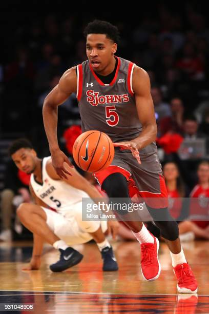 Justin Simon of the St John's Red Storm handles the ball in the first half against the Xavier Musketeers during the Big East basketball tournament...