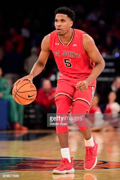Justin Simon of the St John's Red Storm in action against the Georgetown Hoyas during the first round of the Big East tournament at Madison Square...