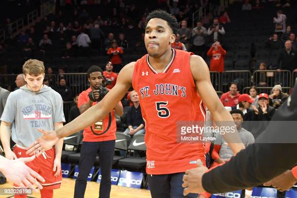 Justin Simon of the St John's Red Storm is introduced before the 1st round of the Big East Basketball Tournament against the Georgetown Hoyas at the...