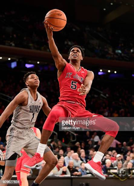 Justin Simon of the St John's Red Storm scores a layup against the Georgetown Hoyas during the first round of the Big East tournament at Madison...