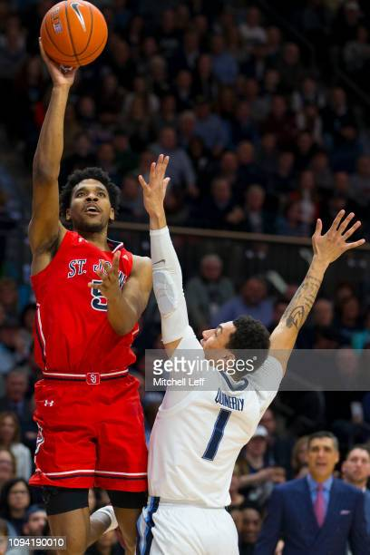 Justin Simon of the St John's Red Storm shoots the ball against Jahvon Quinerly of the Villanova Wildcats at Finneran Pavilion on January 8 2019 in...