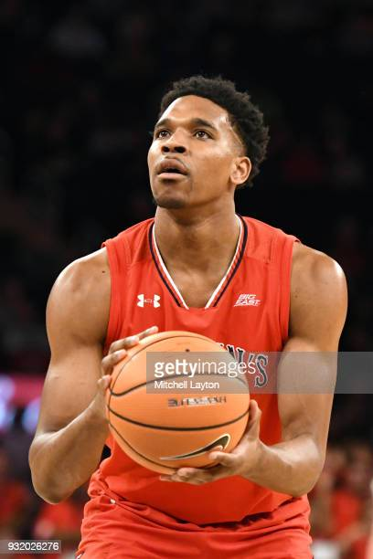 Justin Simon of the St John's Red Storm takes a foul shot during the 1st round of the Big East Basketball Tournament against the Georgetown Hoyas at...