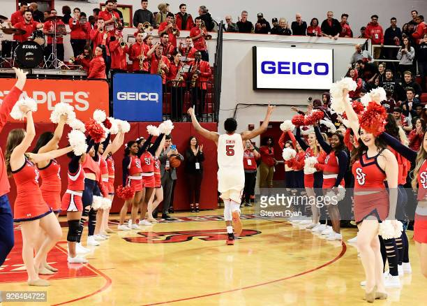 Justin Simon of the St John's Red Storm walks off the court after his teams double overtime victory over the Butler Bulldogs during an NCAA...