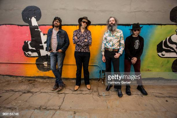 Justin Smith, Dan Cervantes, Ethan Miller and Jeff EcElroy of the band Howlin Rain pose for a portrait before their set at Fingerprints on June 5,...