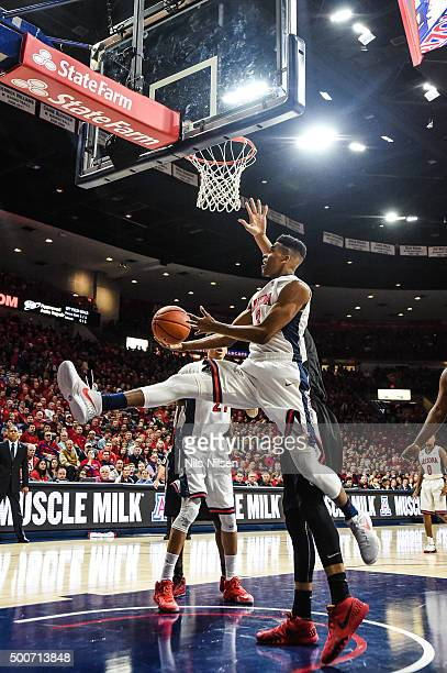 Justin Smith of the Arizona Wildcats shoots the ball during the first half of the college basketball game at McKale Center on December 9 2015 in...