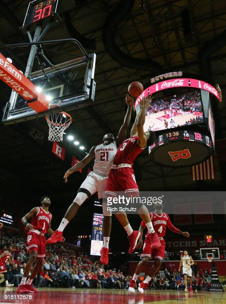 Justin Smith of the Indiana Hoosiers battles Mamadou Doucoure of the Rutgers Scarlet Knights for a rebound during the first half of a game at Rutgers...