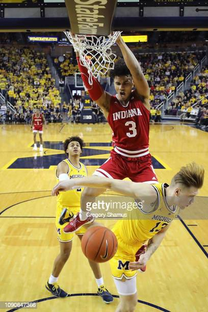 Justin Smith of the Indiana Hoosiers dunks over Ignas Brazdeikis of the Michigan Wolverines during the first half at Crisler Arena on January 06,...