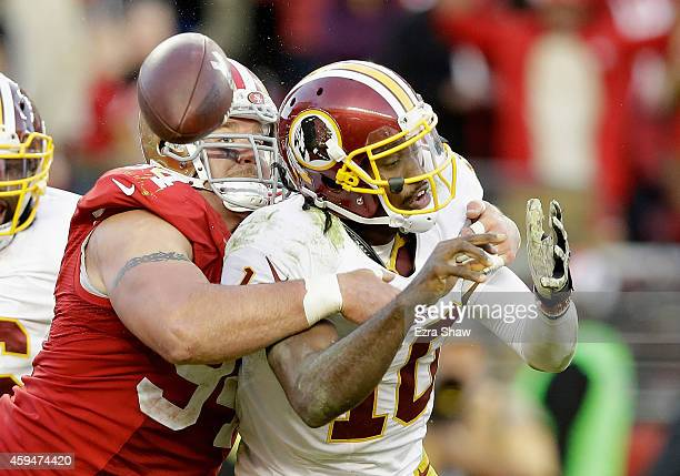 Justin Smith of the San Francisco 49ers forces a fumble from Robert Griffin III of the Washington Redskins in the fourth quarter at Levi's Stadium on...