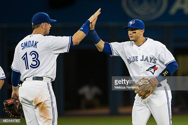 TORONTO ON JULY 30 Justin Smoak high fives Troy Tulowitzki after the Blue Jays win against the Kansas City Royals at the Rogers Centre Smoak used to...