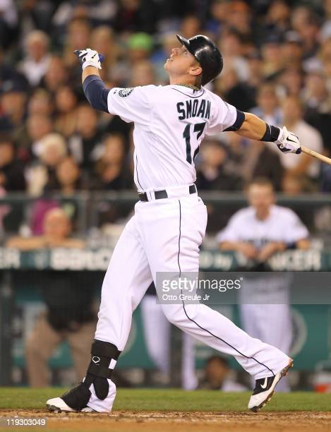 Justin Smoak of the Seattle Mariners flies out to left for the final out in a 31 loss to the Texas Rangers at Safeco Field on July 17 2011 in Seattle...
