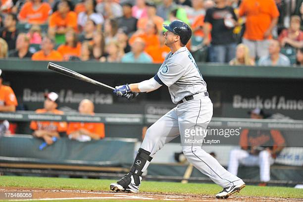 Justin Smoak of the Seattle Mariners hits a solo home run in the second inning during a baseball game against the Baltimore Orioles on August 3 2013...
