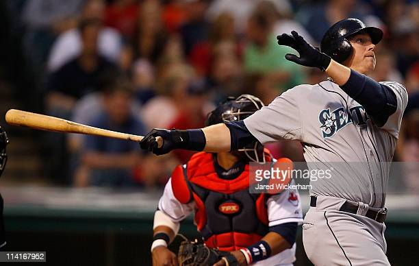 Justin Smoak of the Seattle Mariners watches the ball after hitting a two run home run against the Cleveland Indians during the game on May 13 2011...