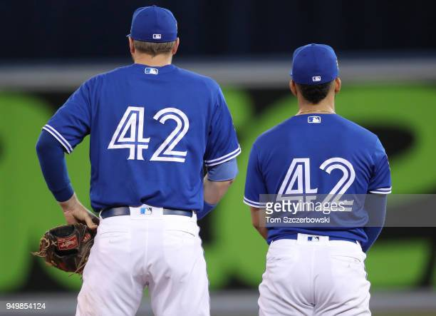 Justin Smoak of the Toronto Blue Jays and Devon Travis wear after their game on Jackie Robinson Day was cancelled twice during MLB game action...