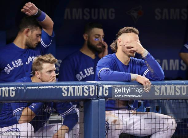Justin Smoak of the Toronto Blue Jays and Josh Donaldson and Luke Maile and Kevin Pillar look on with two outs in the bottom of the ninth inning...