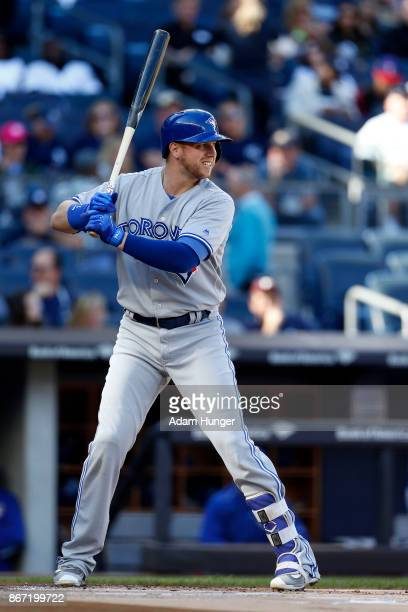 Justin Smoak of the Toronto Blue Jays at bat against the New York Yankees during the first inning at Yankee Stadium on October 1 2017 in the Bronx...