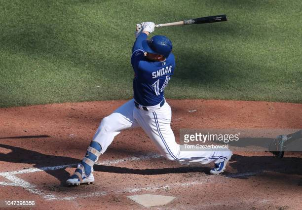 Justin Smoak of the Toronto Blue Jays bats in the ninth inning during MLB game action against the Tampa Bay Rays at Rogers Centre on September 23...