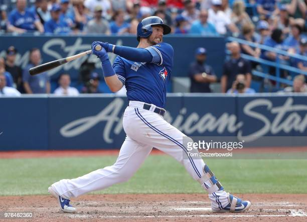 Justin Smoak of the Toronto Blue Jays bats in the tenth inning during MLB game action against the Baltimore Orioles at Rogers Centre on June 9 2018...
