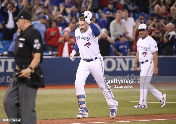 Justin Smoak of the Toronto Blue Jays celebrates as he hits a gamewinning solo home run in the ninth inning during MLB game action against the Tampa...