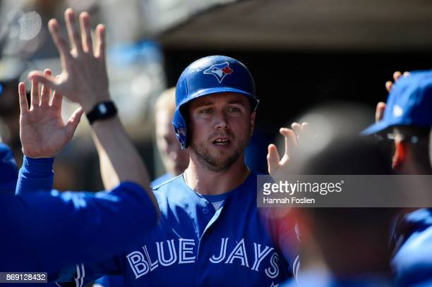 Justin Smoak of the Toronto Blue Jays celebrates scoring a run against the Minnesota Twins during the game on September 17 2017 at Target Field in...