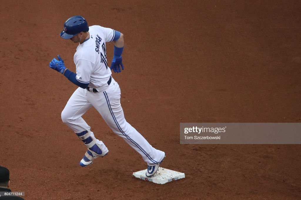 Justin Smoak #14 of the Toronto Blue Jays circles the bases after hitting a three-run home run in the first inning during MLB game action against the Boston Red Sox at Rogers Centre on June 30, 2017 in Toronto, Canada.