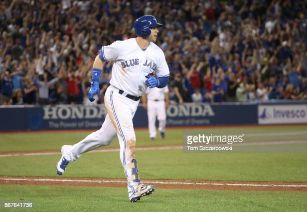 Justin Smoak of the Toronto Blue Jays circles the bases after hitting a gametying tworun home run in the ninth inning during MLB game action against...