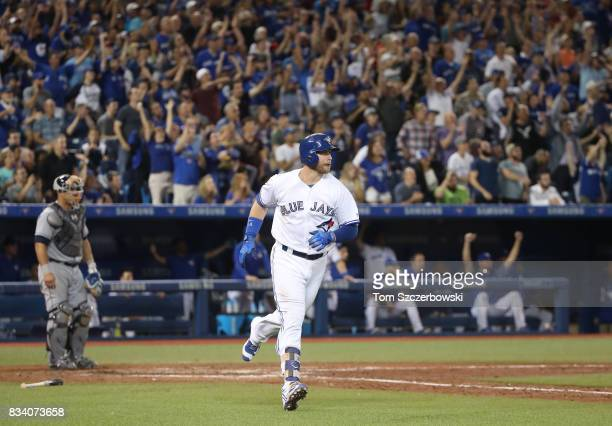 Justin Smoak of the Toronto Blue Jays circles the bases as he hits a tworun home run in the eighth inning during MLB game action against the Tampa...
