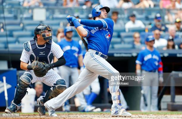 Justin Smoak of the Toronto Blue Jays follows through on a third inning two run home run against the New York Yankees at Yankee Stadium on July 5...