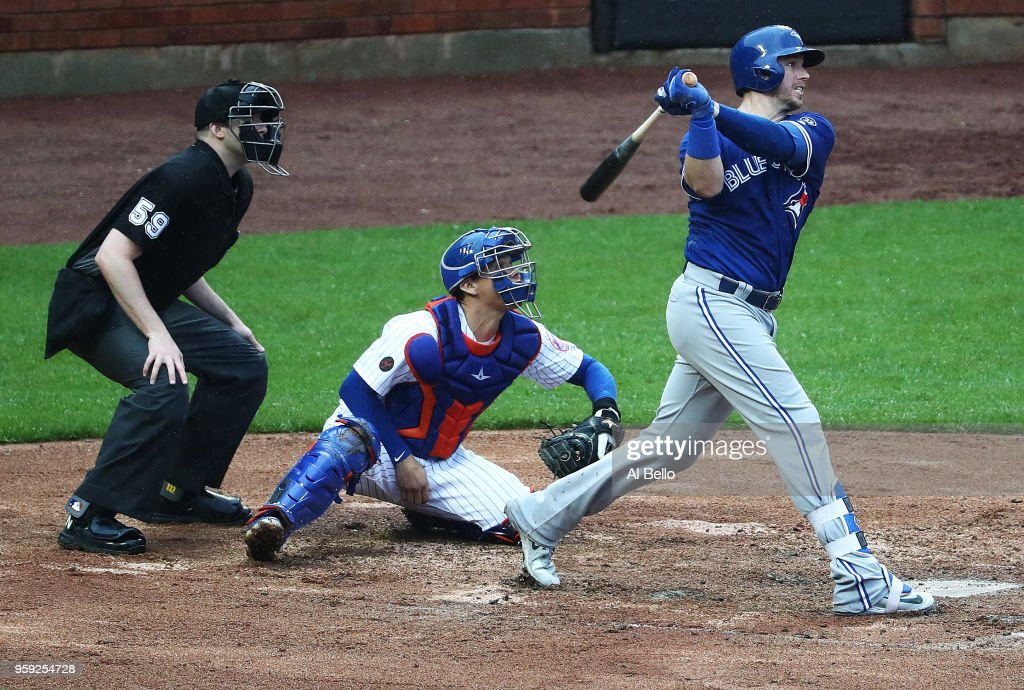 Justin Smoak #14 of the Toronto Blue Jays hits a double and drives in two runs in the sixth inning against the New York Mets during their game at Citi Field on May 16, 2018 in New York City.