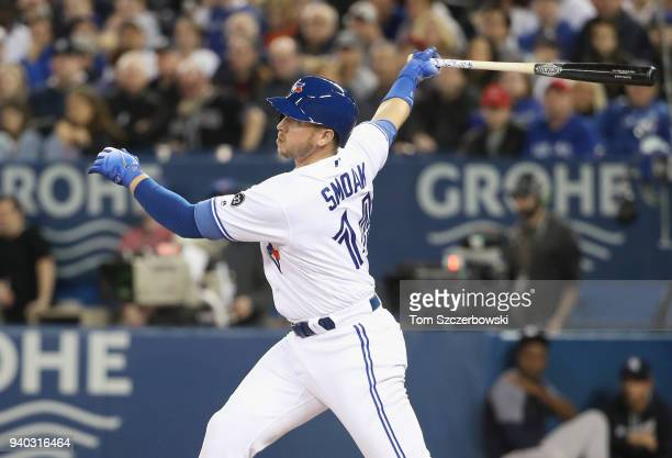 Justin Smoak of the Toronto Blue Jays hits a double in the first inning during MLB game action against the New York Yankees at Rogers Centre on March...
