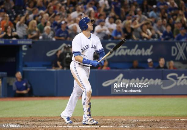 Justin Smoak of the Toronto Blue Jays hits a gametying tworun home run in the ninth inning during MLB game action against the Oakland Athletics at...