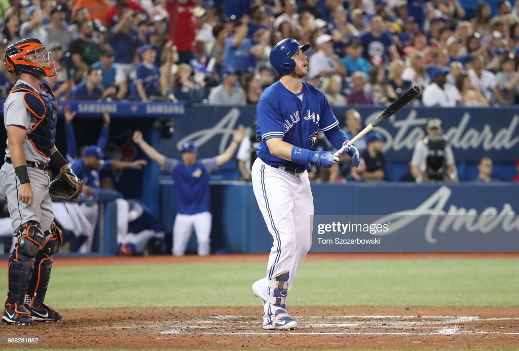 Justin Smoak #14 of the Toronto Blue Jays hits a game-winning solo home run in the ninth inning during MLB game action against the Detroit Tigers at Rogers Centre on June 30, 2018 in Toronto, Canada.