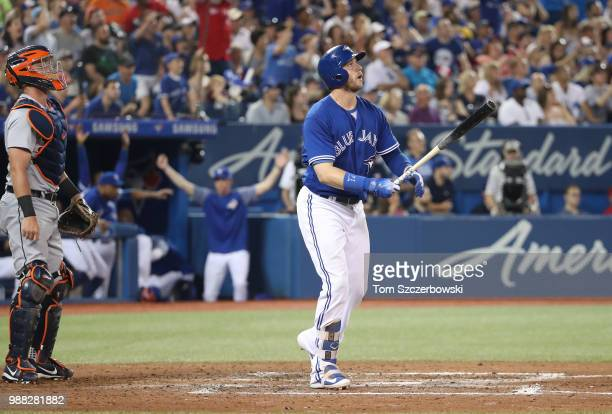 Justin Smoak of the Toronto Blue Jays hits a gamewinning solo home run in the ninth inning during MLB game action against the Detroit Tigers at...