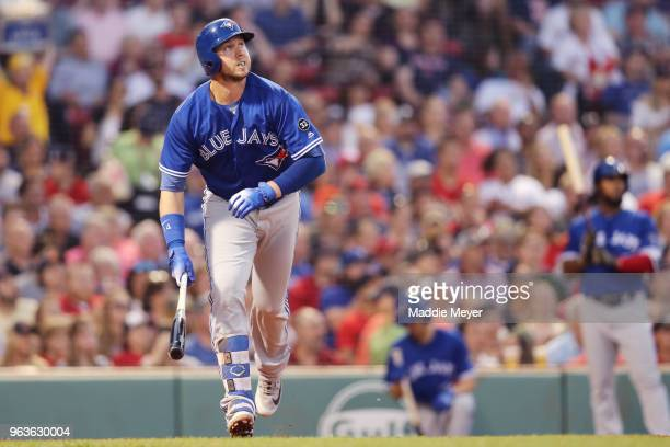 Justin Smoak of the Toronto Blue Jays hits a home run against the Boston Red Sox during the fourth inning at Fenway Park on May 29 2018 in Boston...