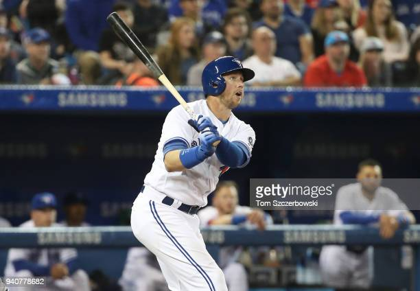 Justin Smoak of the Toronto Blue Jays hits a single in the fifth inning during MLB game action against the New York Yankees at Rogers Centre on April...