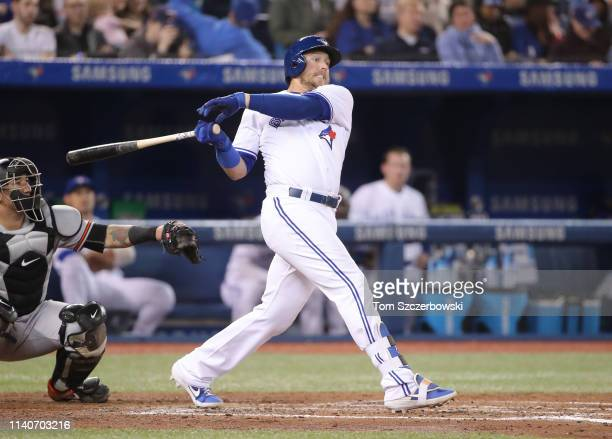 Justin Smoak of the Toronto Blue Jays hits a single in the fourth inning during MLB game action against the Baltimore Orioles at Rogers Centre on...