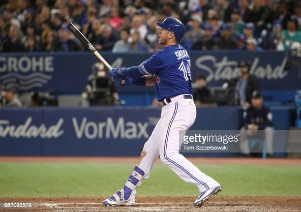Justin Smoak of the Toronto Blue Jays hits a solo home run in the seventh inning during MLB game action against the Seattle Mariners at Rogers Centre...