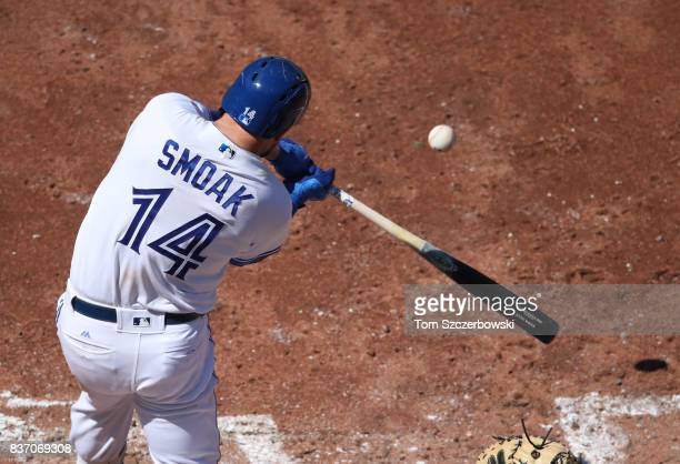 Justin Smoak of the Toronto Blue Jays hits a solo home run in the seventh inning during MLB game action against the Pittsburgh Pirates at Rogers...