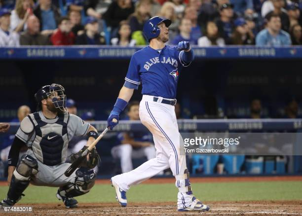 Justin Smoak of the Toronto Blue Jays hits a tworun home run in the sixth inning during MLB game action against the Tampa Bay Rays at Rogers Centre...