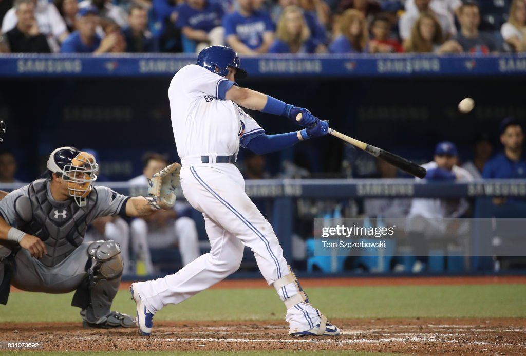 Justin Smoak #14 of the Toronto Blue Jays hits a two-run home run in the eighth inning during MLB game action against the Tampa Bay Rays at Rogers Centre on August 17, 2017 in Toronto, Canada.