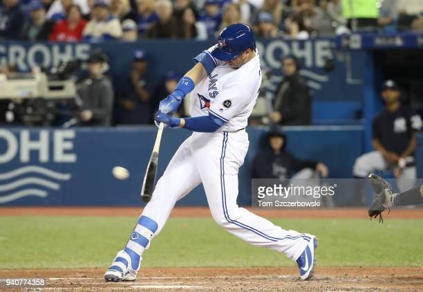 Justin Smoak of the Toronto Blue Jays hits a tworun home run in the seventh inning during MLB game action against the New York Yankees at Rogers...