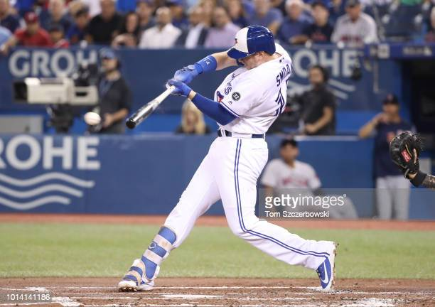 Justin Smoak of the Toronto Blue Jays hits an RBI single in the first inning during MLB game action against the Boston Red Sox at Rogers Centre on...
