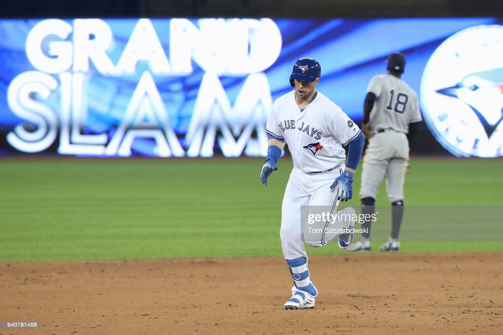Justin Smoak #14 of the Toronto Blue Jays is circles the bases after hitting a grand slam home run in the eighth inning during MLB game action against the New York Yankees at Rogers Centre on April 1, 2018 in Toronto, Canada.